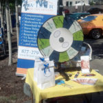 Spin and win at the Wiser Home Care Services Hot Cars and Ice Bucket Challenge event.